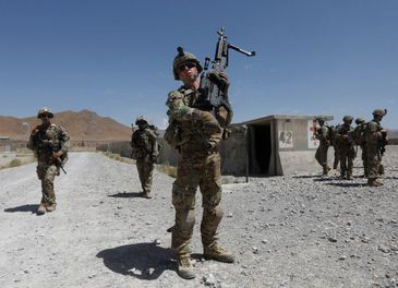 FILE PHOTO: U.S. troops patrol at an Afghan National Army (ANA) base in Logar province, Afghanistan